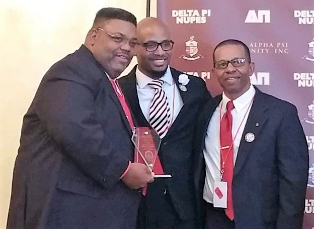 24th Province Polemarch Kevin D. Kyles receiving a Special Achievement Award from Brothers Kyle Barnes and David Branch
